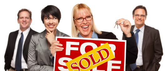 Real Estate Team Behind with Blonde Woman in Front Holding Keys and Sold For Sale Real Estate Sign Isolated on a White Background.
